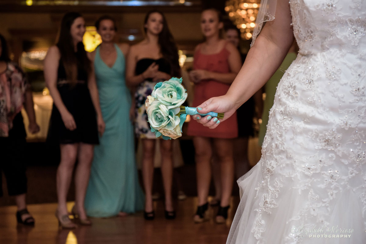 Picture of bride throwing the bouquet at a wedding reception at the Guy's Party Center in Akron, OH