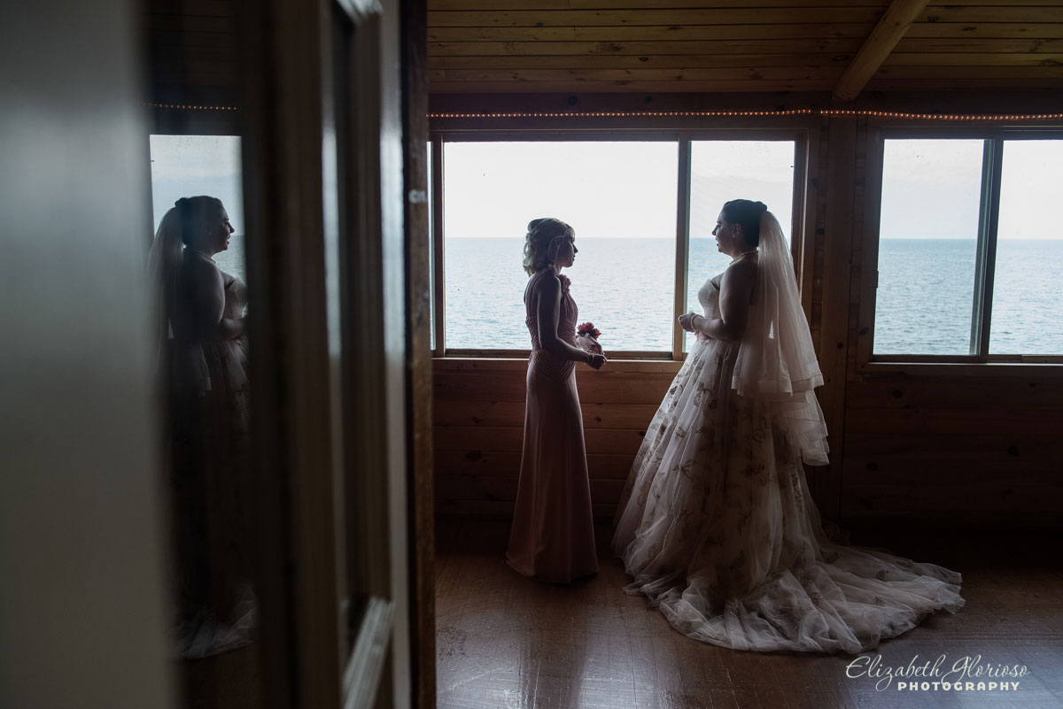 Photo of bride and bridesmaid at The Club House at Vermilion-on-the-Lake in Vermilion, OH