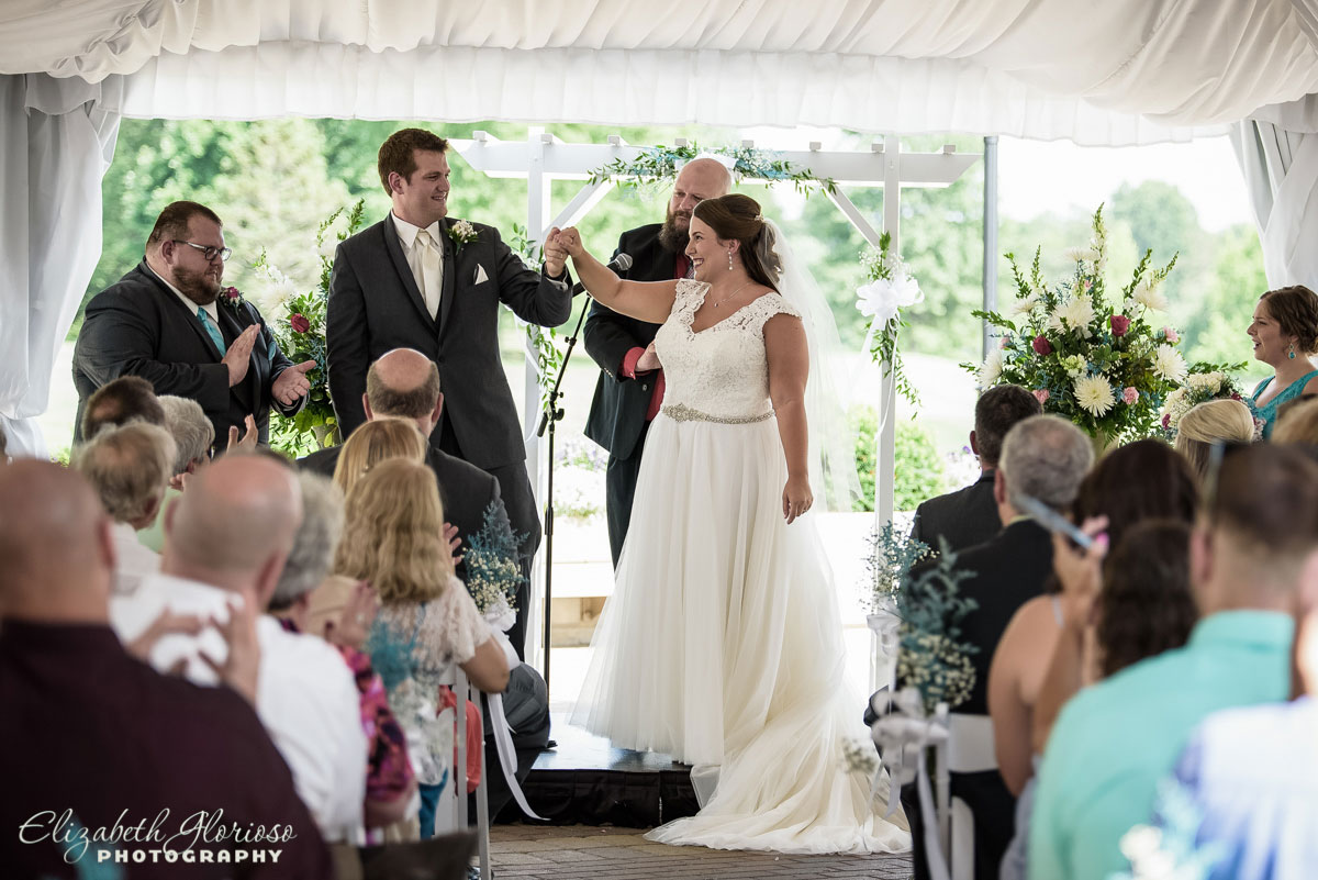 Photo of bride and groom at wedding ceremony at the Westfield Group County Club in Westfield Center, OH