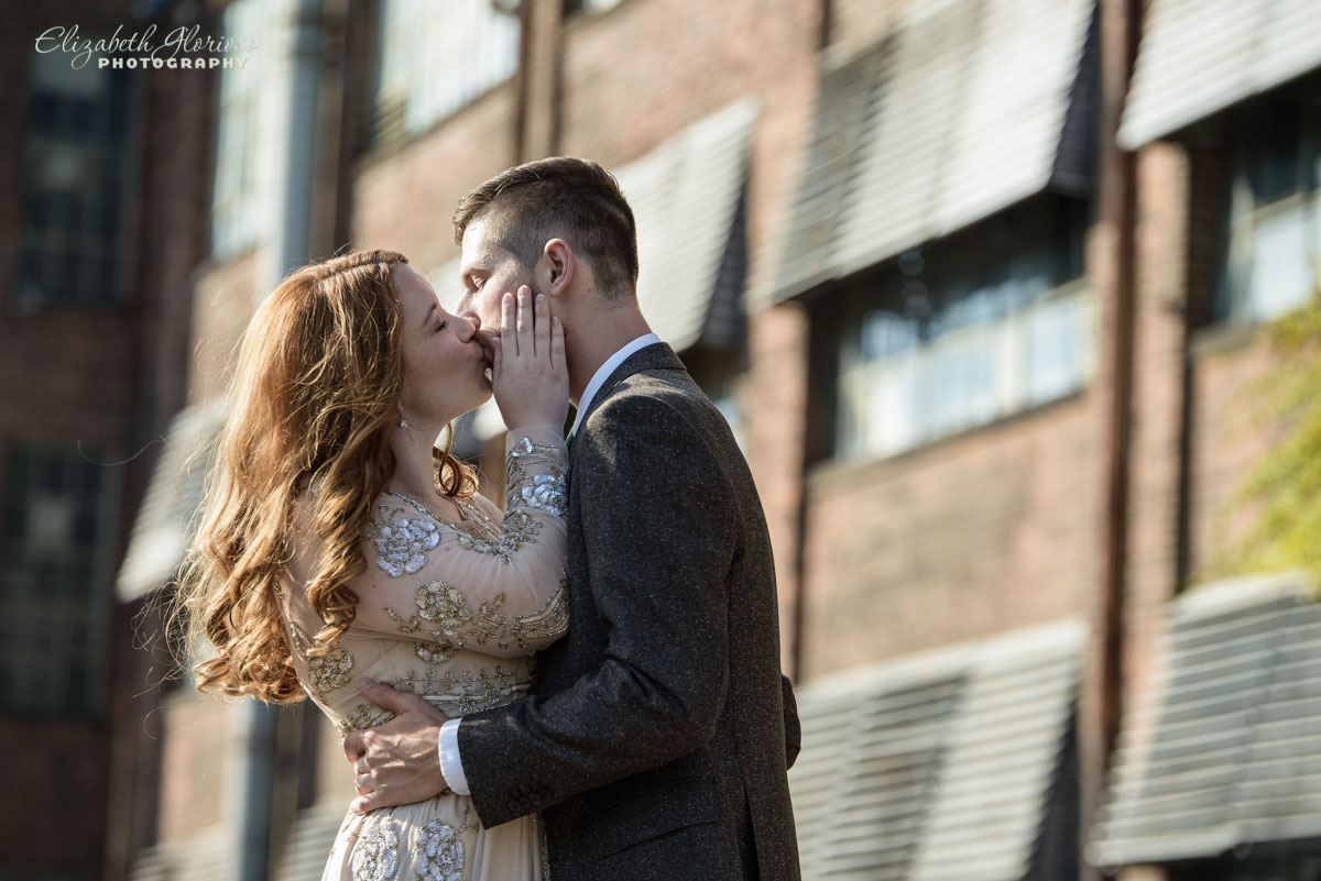 Wedding portrait of bride and groom kissing at the SmArt Space West 78th Street Studios Cleveland