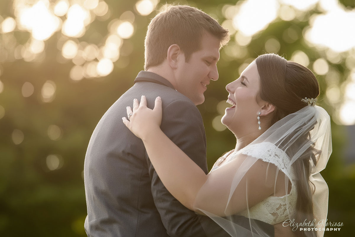 Wedding portrait of bride and groom embracing, taken at the Westfield Country Club in Westfield, OH