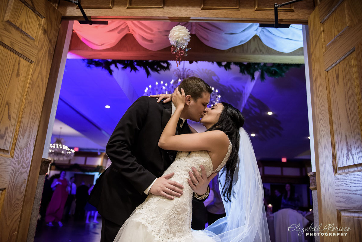 Photo of bride and groom kissing at Carrie Cerino's in North Royalton, OH