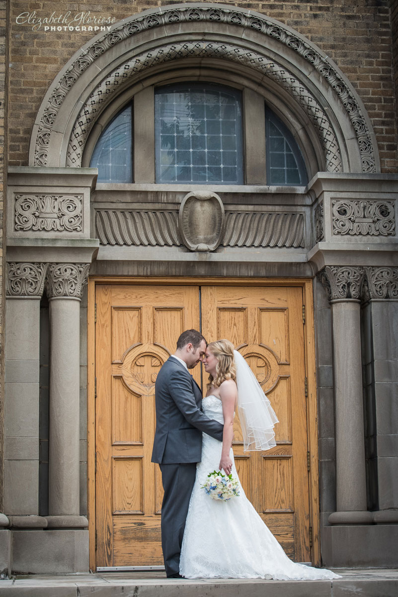 Photo of bride and groom outside of St. John Cantius in Cleveland, OH