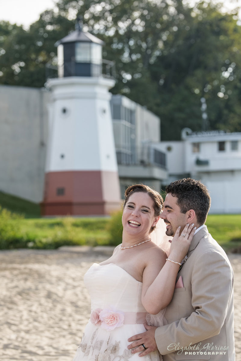Portrait of bride and groom taken near the lighthouse in Vermilion, Ohio