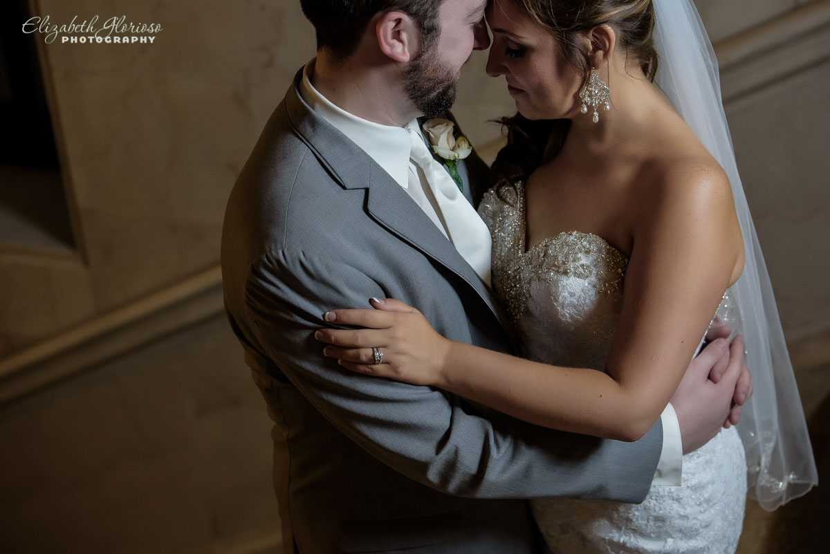Photo of bride and groom embracing at the Cleveland Public Library