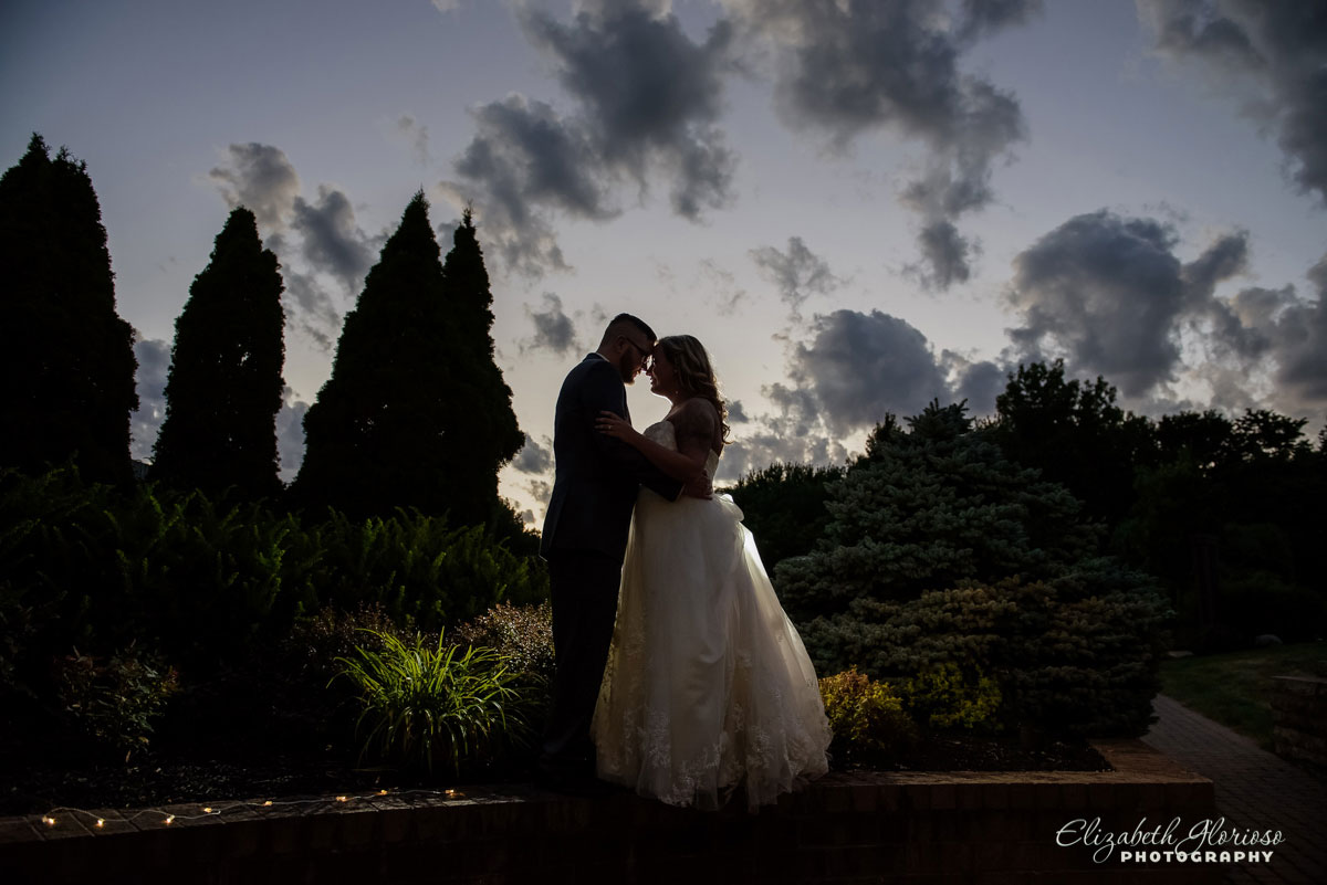 Photo of bride and groom outside of St. Clarence in North Olmsted, OH